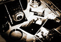 Still life. Vintage stylized lithprint with retro photo camera a