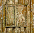 Shuttered window of old wooden house