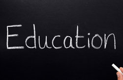 education written on a blackboard stock photo