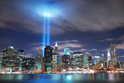 Photo of New York City Manhattan at night with World Trade Center beams of light coming up from the ground