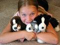 Girl hugging her plush toys