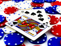 Red White and Blue Poker Chips and Black Jack on White Backgroun