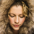 Woman with fur hood.
