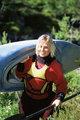 Woman carrying kayak