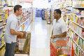 Two men meeting in supermarket