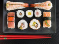 Selection of Seafood And Vegetable Sushi With Chopsticks