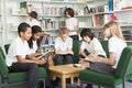 Junior school students working in a library