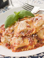 Veal and Sage Ravioli with Tomato and Basil Sauce with Grated Pa