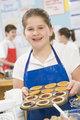 Schoolgirl at school in a cooking class