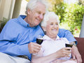 Senior couple relaxing with glass of wine