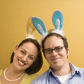 Couple wearing rabbit ears.