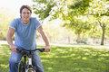 Man outdoors on bike smiling