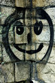Smiley face on a stone wall