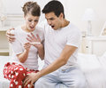 Surprised couple looking at a pregnancy test