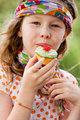Eating a cupcake