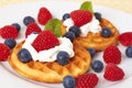 Belgian waffles with berries and cream