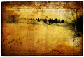 Old turned yellow paper with a dark landscape