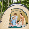 Family sitting in tent