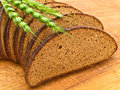 Bread and grain at wooden board