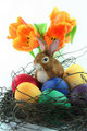 Easter basket with eggs and Easter bunny and tulip