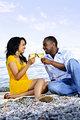 Happy couple having wine on beach