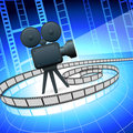 Film camra and filmstrip on blue background