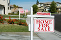 Row of Foreclosure Home For Sale Real Estate Signs