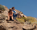 Hikers in desert look at distant object