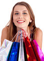 Woman holding lots of shopping bags in her hand