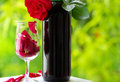 Petals of rose in a glass .