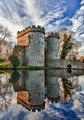 Whittington Castle in Shropshire reflecting on moat