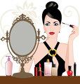 Glamour woman applying makeup