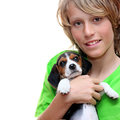 Child holding, pet beagle puppy dog
