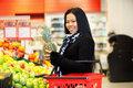 Asian Woman Buying Fruit