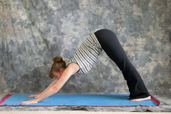 woman doing yoga posture adho mukha svanasana or downward