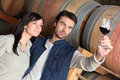 Couple wine tasting in a cellar