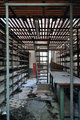 empty shelves in abandoned factory