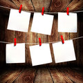 Blank note paper hanging on rope in wooden box