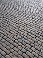 Old English cobblestones road in Plymouth close up.