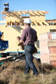 Roofer working on unfinished house