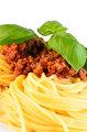 Spaghetti bolognese with leaf basil