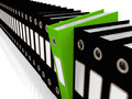 Green File Amongst Black For Getting Office Organized