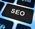 SEO Computer Key Showing Internet Marketing And Optimization