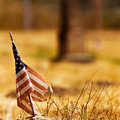 Vintage looking photo of a tattered american flag