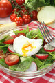 Salad with poached egg and onions