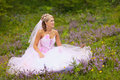 Beautiful bride is sitting in the forest
