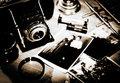Still life. Vintage stylized lithprint with retro photo camera a