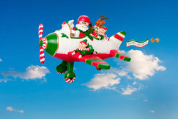 Flying Santa Claus With Elves In Airplane Stock Photo